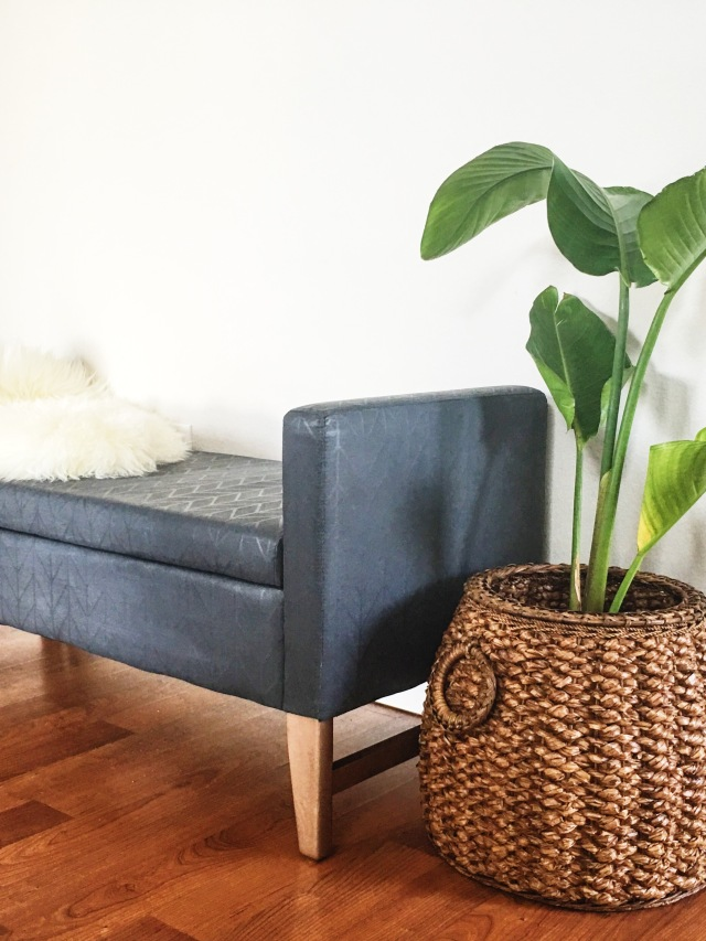 Recycled bench with Chalk paint - sanded and waxed. Charcoal grey with copper feet on existing furniture. Upcycle project design. Sheepskin throw and handwoven basket with plant