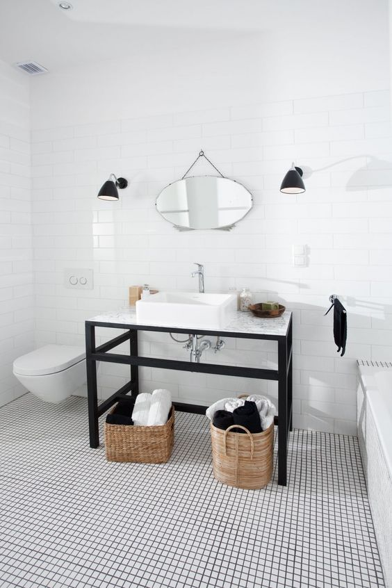 White Bathroom, Black tile grout, Single Sink bathroom with steel legs and woven baskets