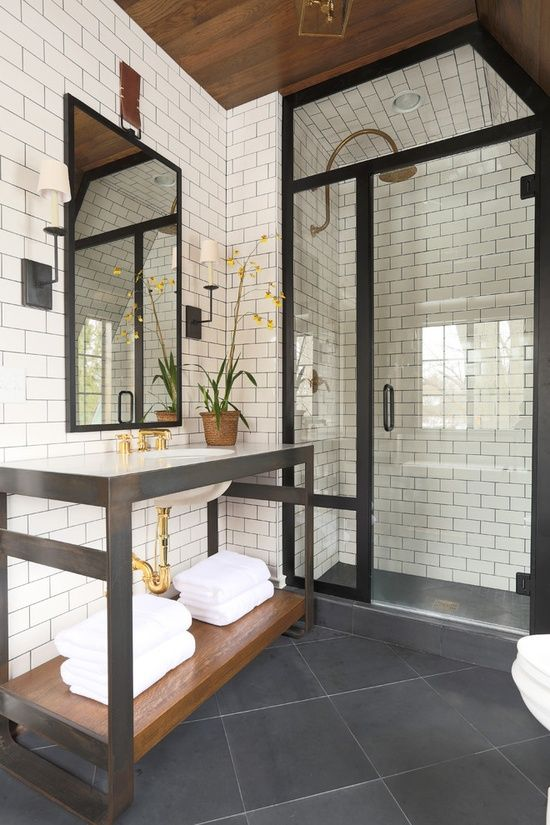 Black steel trim bathroom, white subway tile - wall sconces - exposed wood