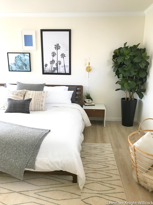 California home master bedroom before and after photos. Boho bedroom makeover - neutral bedroom with artwork, palm trees, mud cloth pillows. Surf beach art and mid century bench