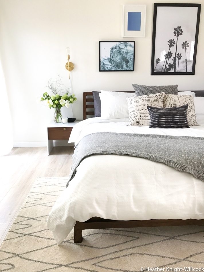 California home master bedroom before and after photos. Boho bedroom makeover - neutral bedroom with artwork, palm trees, mud cloth pillows