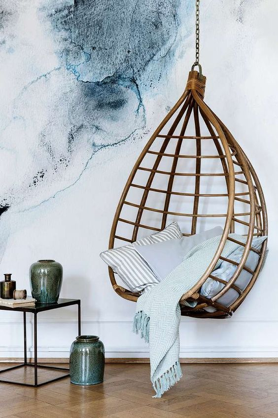 Large scale water color - ink blue artwork design and hanging basket. Incredible styling with pottery and mixed linens