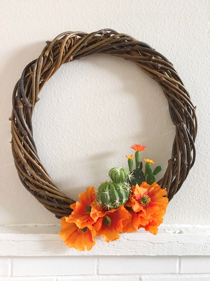 Autumnal succulent wreath made with orange poppies and faux succulent cactus on a wood wreath. holiday festive wreath - perfect for fall and autumn. DIY wreath