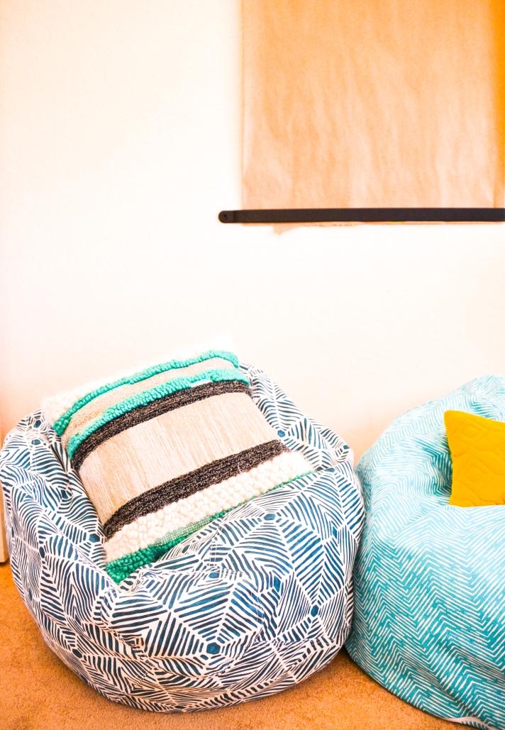 Little Girls playroom - fun, colorful playroom designed by Calirose Design in Southern California. Bohemian playroom. Mudcloth pattern wall mural - handprinted wall mural. butcher block wall paper. bean bag chairs