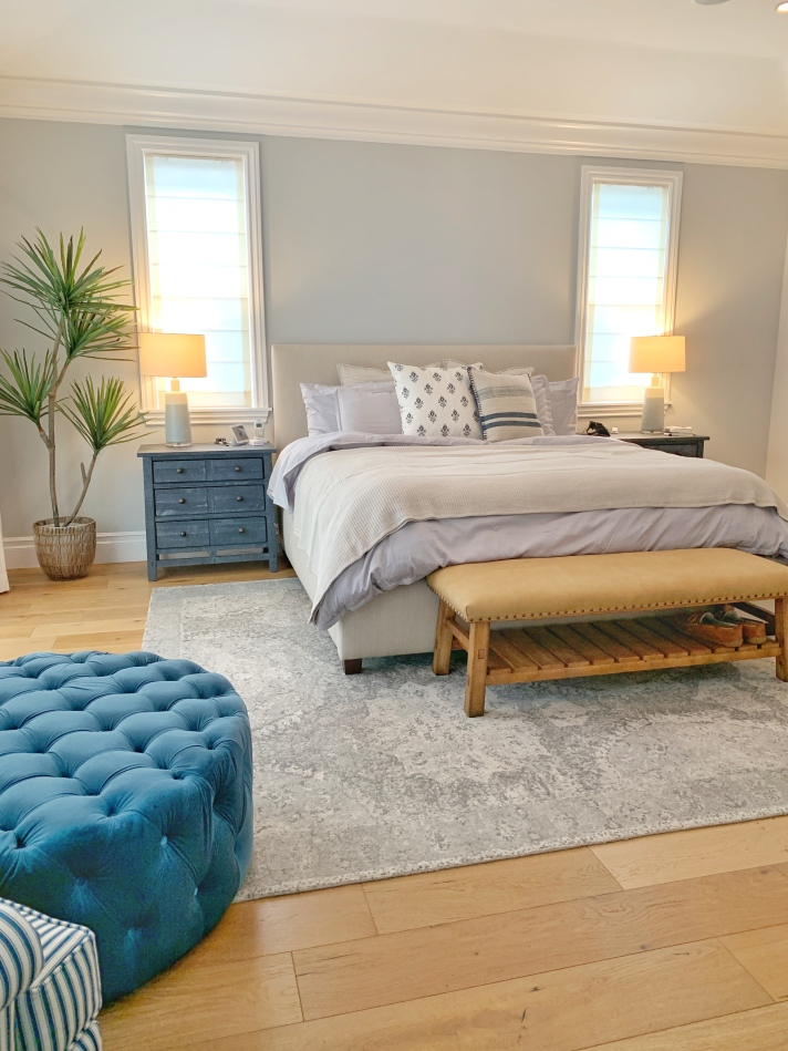 Master bedroom before and after makeover - light and airy bohemian look with ask oak floors and blue. blue and tan bedroom design by Heather Knight-Willcock from Calirose Lifestyle based in Los Angeles California