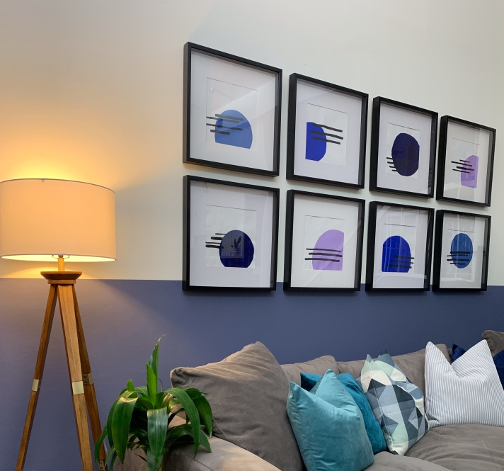 before and after living room makeover with a large grey sectional and a modern vibe. mid century modern living room details. blue living room. purple living room.